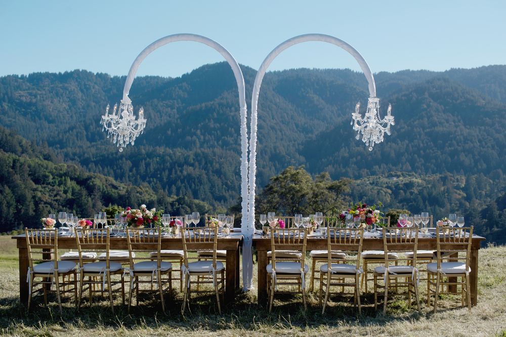 Rustic chic outdoor table design by  Amazae Events  at the Mountain Winery.