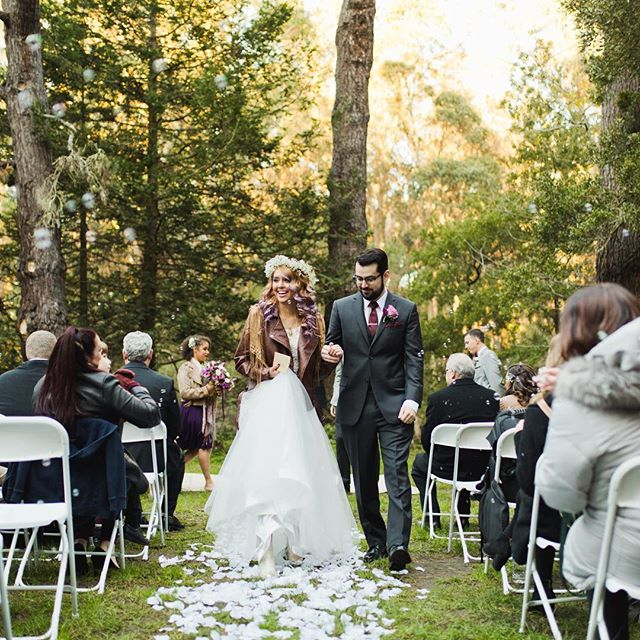 """{ Edgy Bride } Walking down the isle with a leather jacket? Yes please! We have some one of the trendiest #brides 👰🏼 #realwedding #juleechic ……………………………………………………………………………. {TOP} """"Sugar"""" {SKIRT} """"Cupid"""" // 📸 @beccabliss // 💄 @makeupbypurrrl // Hair @dre_yeahhhair"""