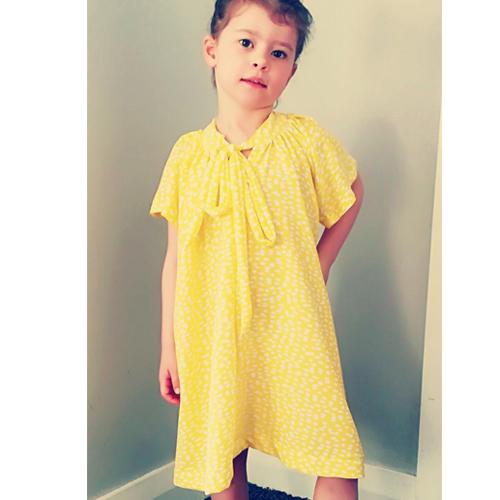 Rosetta dress   Little Miss Auckland wearing the  Rosetta dress  in yellow printed modal fabric.