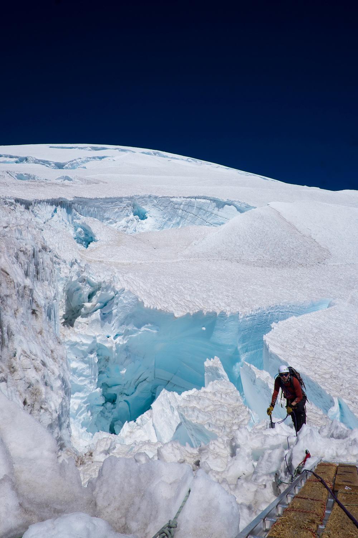 Huge crevasse crossing at 13k ft on the Nisqually Glacier, Mt. Rainier.