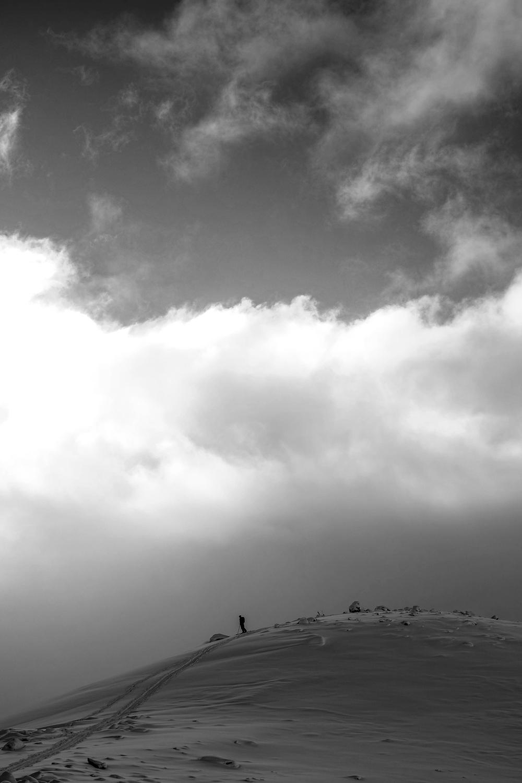 A skier prepares to drop in on the Muir Snowfield.
