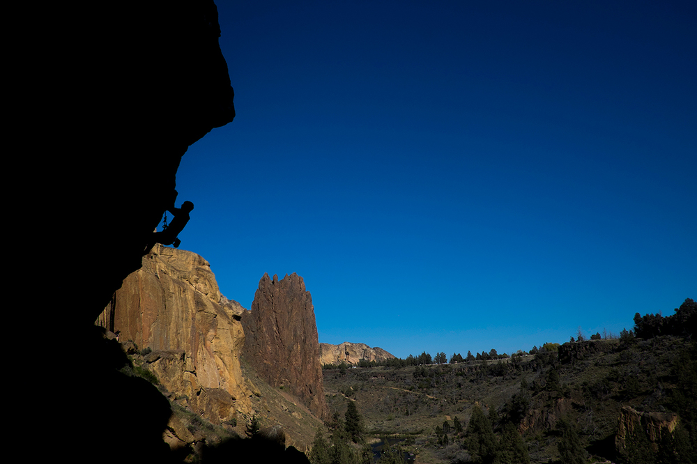 A climber attempts, Chain Reaction, 5.12c, Smith Rock, Oregon