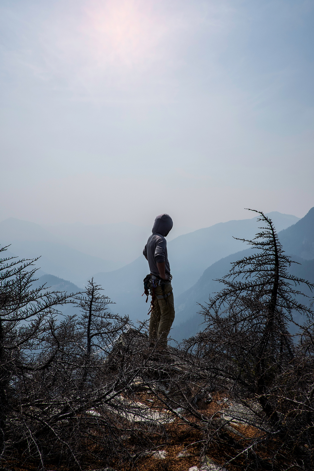 A climber surveys Snoqualmie Pass, shrouded in smoke from the fires in Washington state. August 22nd, 2015.