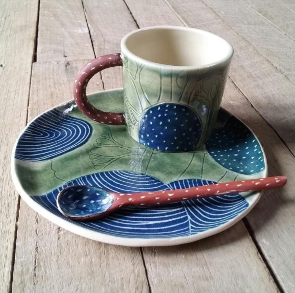 Into the wild  dessert plate, cup and spoon by Yvette DeLacy (Mountain Clay). Spoon $18, plate and cup $58 each. (Items may vary slightly to the picture)