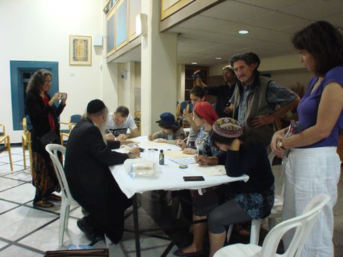 Teacher and Mentor, Dov Laimon (left) teaches a scribing workshop