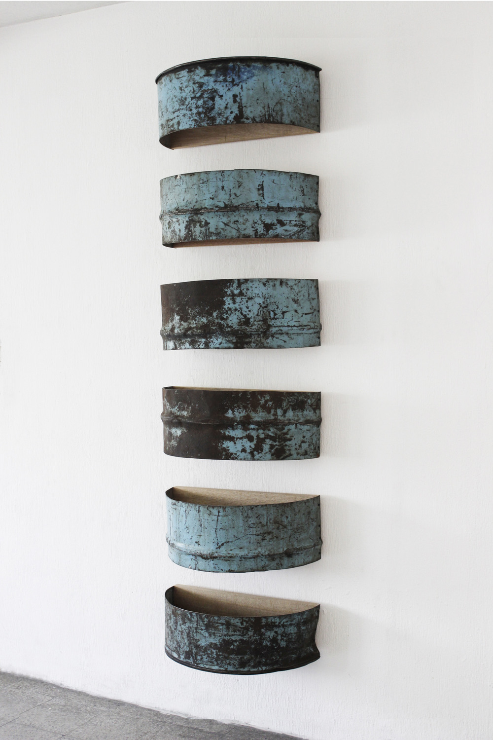 Repetition No. 3, 2014  Found iron barrel fragments assembled on wood panels, protected with acryloid.   202 x 58 x 31 cm. [79 1/2 x 22 13/16 x 12 3/16]   Photo by Diego Sagastume
