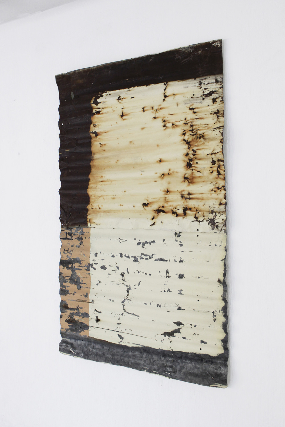 Recomposition No.4   2014  Found painted zinc sheet assembled on wood canvas, conserved with acryloid.   Photo credit: Diego Sagastume