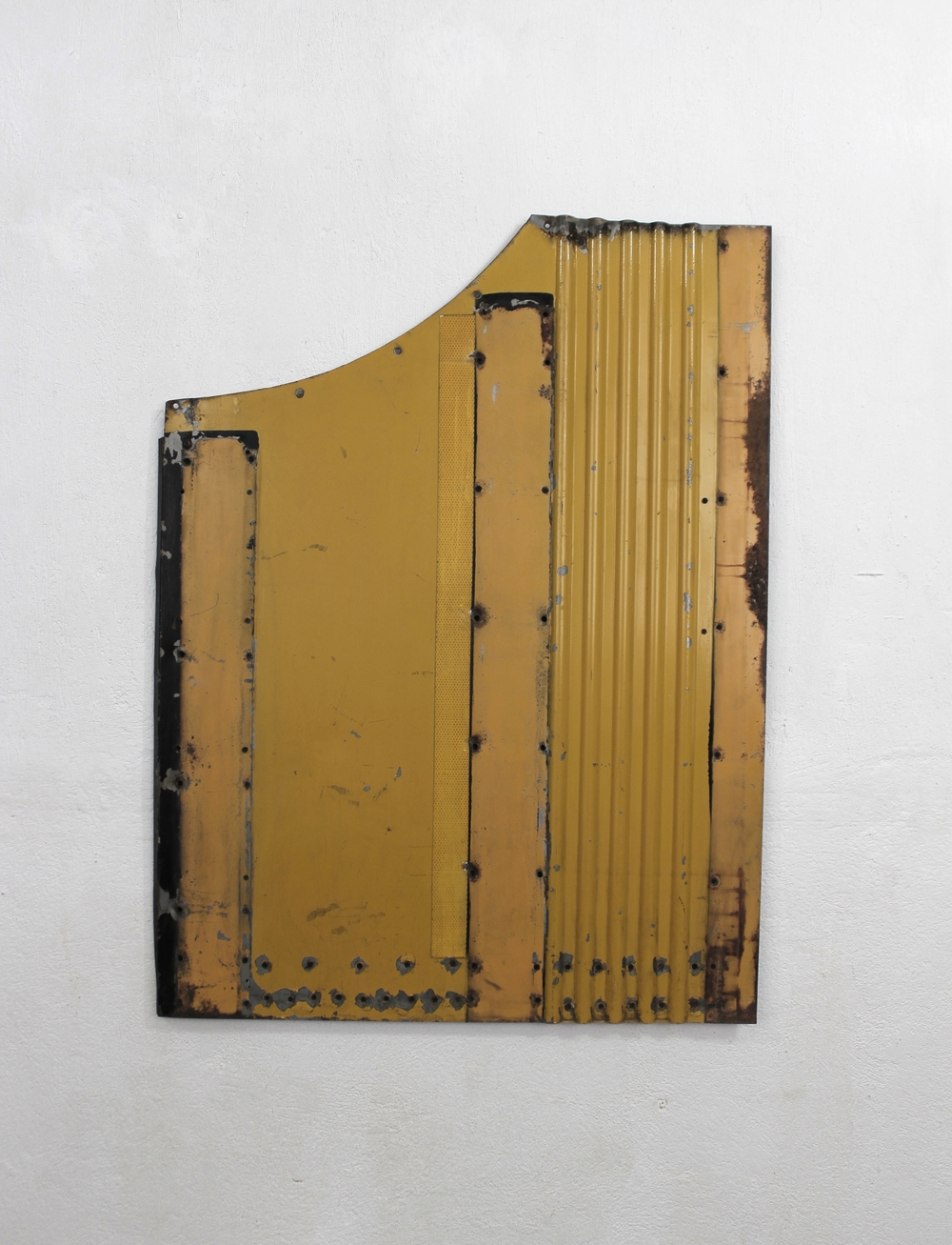 Geometric Relief No. 5   2014  Found rusted urban bus external panel, automotive paint, polyvinyl and acryloid.   115 x 87 x 3 cm   Photo credit: Diego Sagastume