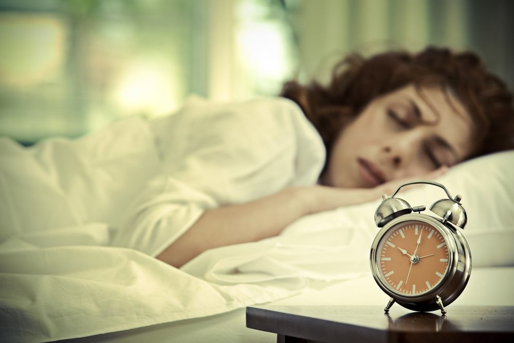 20150806170621-woman-sleeping-habbits-clock-sleep.jpeg