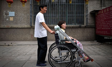 Disabled Chinese rights activist Ni Yulan and her husband Dong Jiqin. Photo: Andy Wong/Associated Press