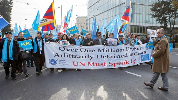 Source: AP ( Uyghur protesters outside the UN Headquarters in Geneva, Nov. 6, 2018. )