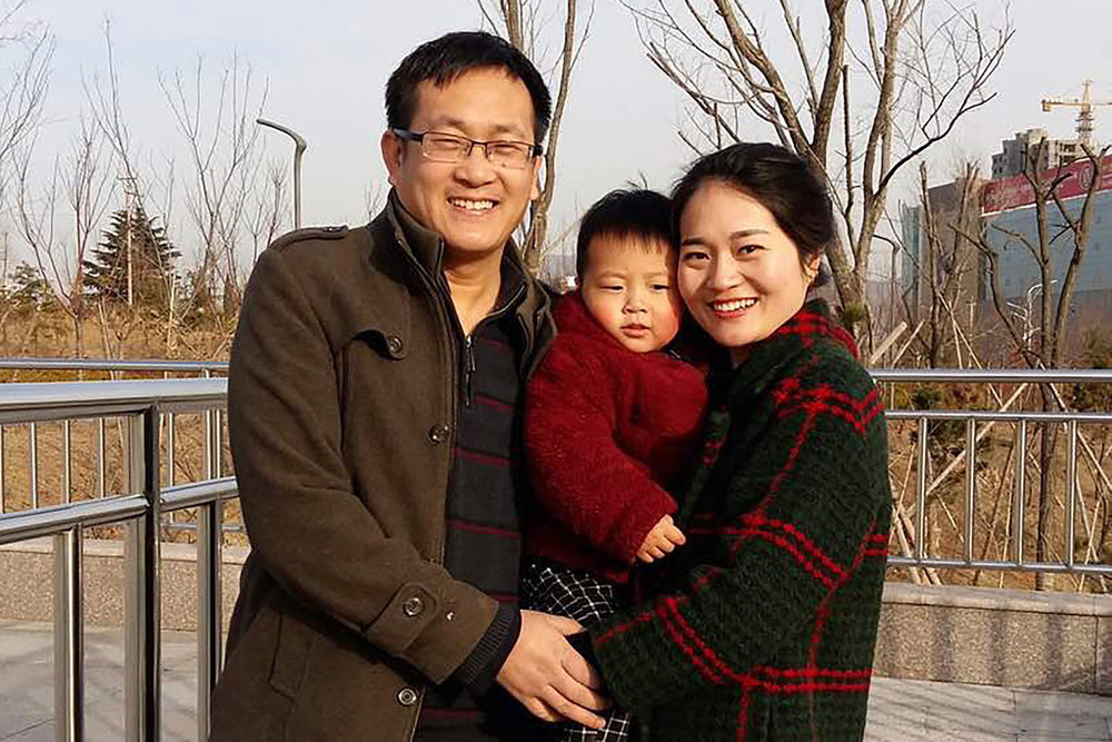 Wang Quanzhang and his wife Li Wenzu, with their child. Credit: Li Wenzu, via Associated Press