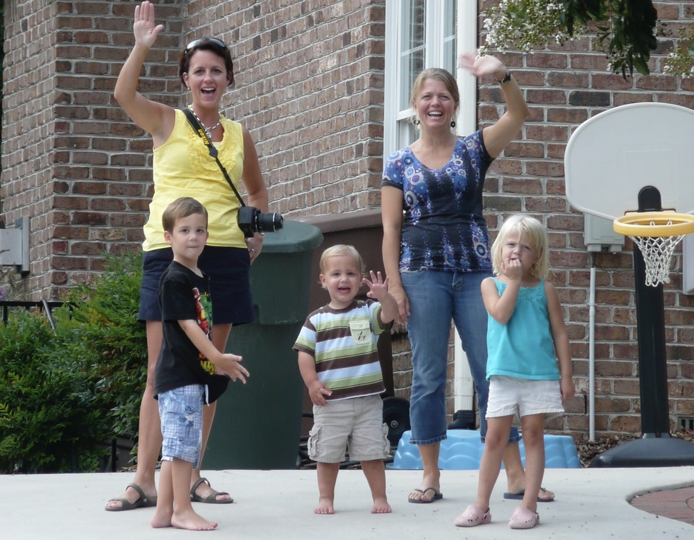 Our lovely neighbours in Greensboro waving good-bye as we are moving away.