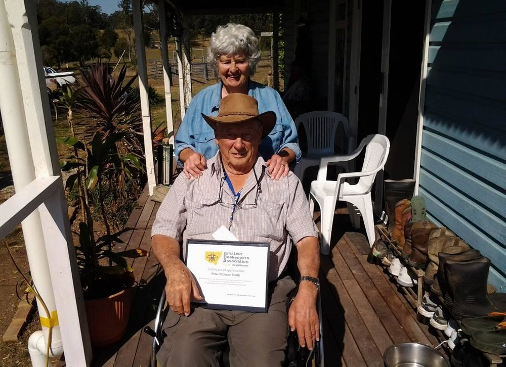 Peter and Barbara with the certificate of merit.