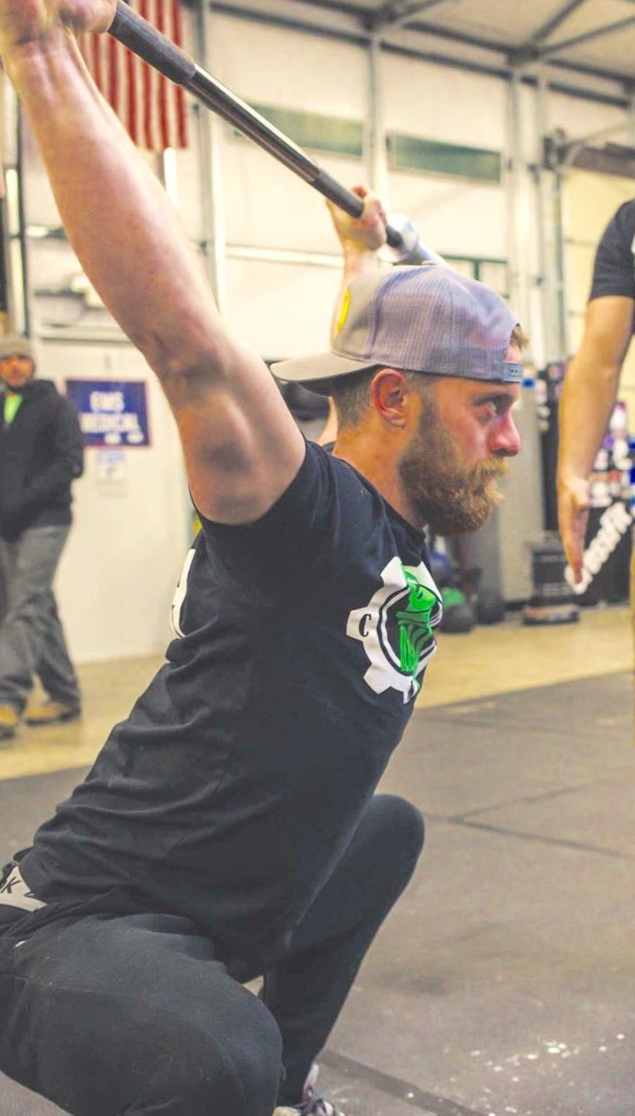 CF-L1 Tony Hannah - Coach Tony began his CrossFit journey 3 years ago while enrolled at Tusculum College, in Greeneville TN. After gaining a very healthy 40 pounds to his frame, Tony acknowledged the changes CrossFit made both physically and mentally in himself and wanted to assist others in the same way. This led Tony to become an assistant Strength Coach at Tusculum during his Junior and Senior Years. He spent this time focusing on olympic lifting and CrossFit methodology which led him to becoming a CrossFit Level 1 trainer. Coach Tony has a passion for country music, the competitive nature of a feral house cat, and a magnificent beard all of which contribute to his talent at coaching others. Coach Tony is an asset to the Kolòna coaching team!