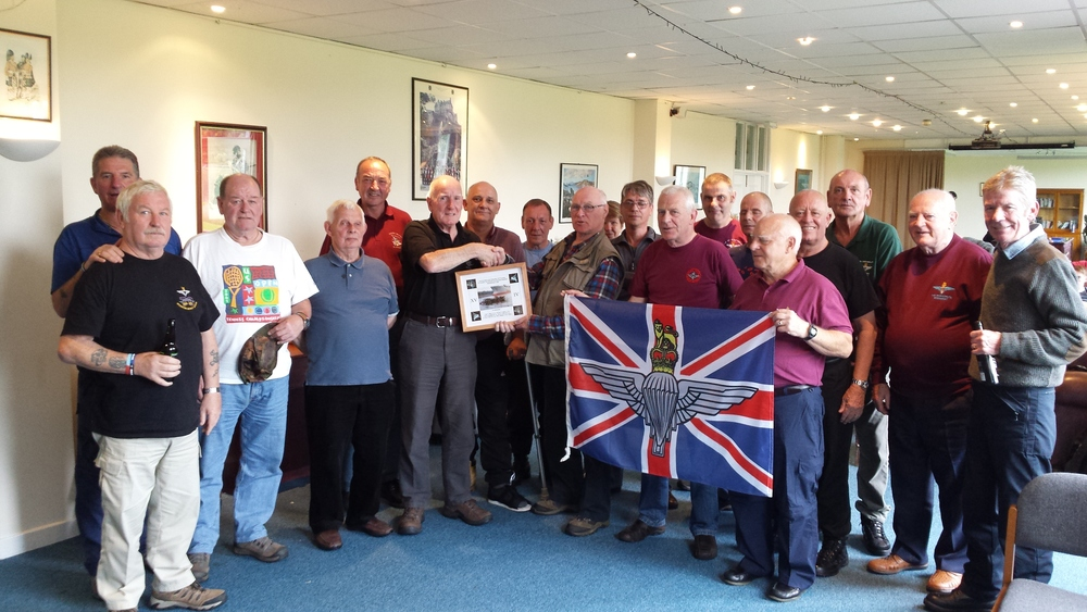 "EAST meets WEST - Lothian Branch chairman - Davie Adams and members of his branch being presented with a ""KIEL CANAL"" framed photo of the disaster by Chairman of Glasgow and West of Scotland Branch chairman - Frank Cameron assisted with his branch members"