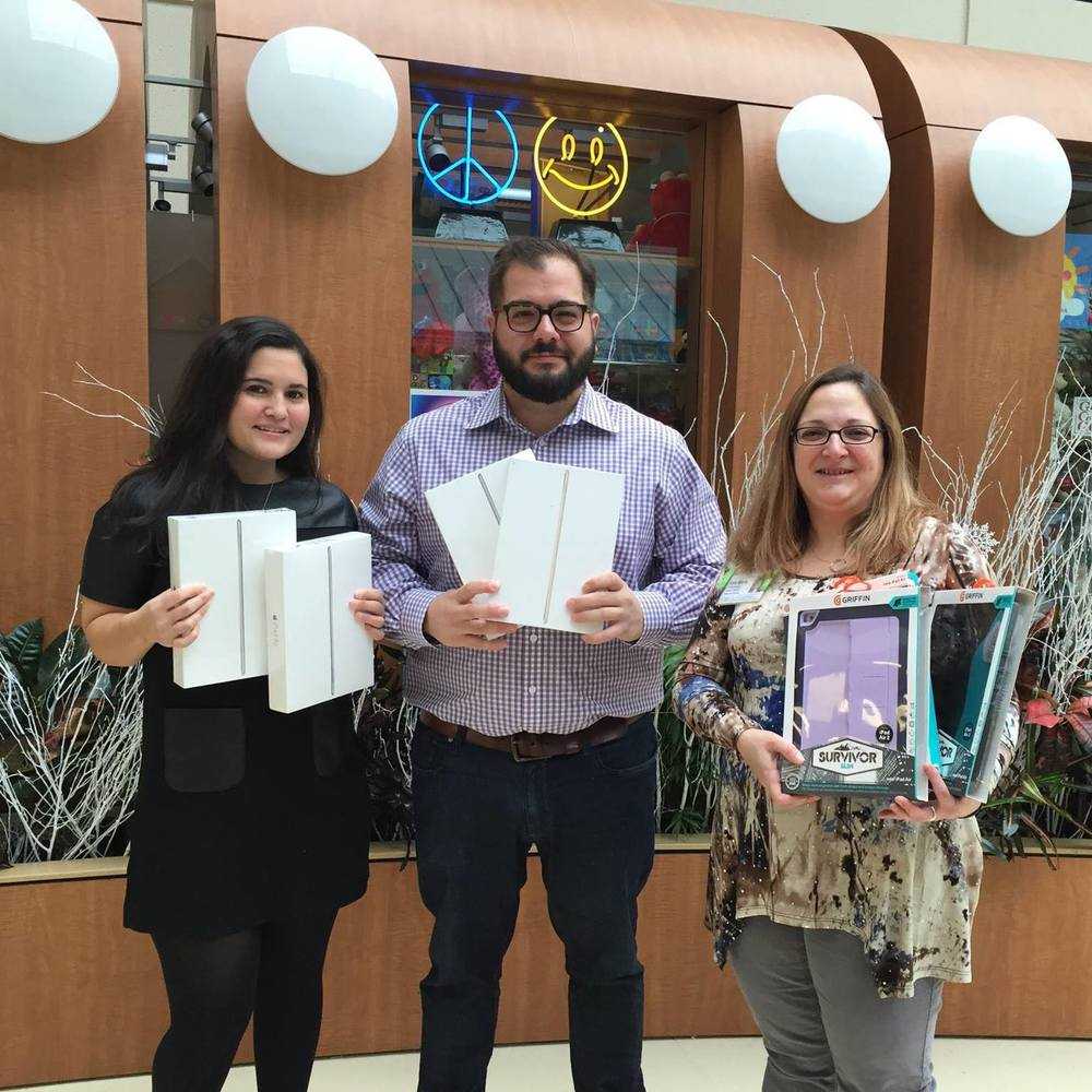 The Summer Hope Foundation founder, Eddie Mouradian, and board member, Carla Alvarez Woitovich, presenting first iPad Project donations to Cohen Children's Hospital in 2015.