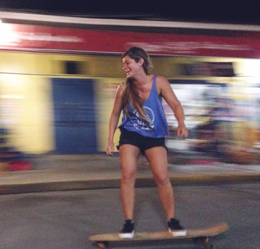 Nena Belen of  TuCamino Travel  skateboarding around the surf shop... SDJS has lots of fun, paved hills.
