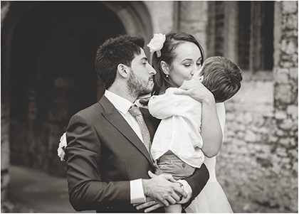 Photo of bride and groom with their son in Oxfordshire