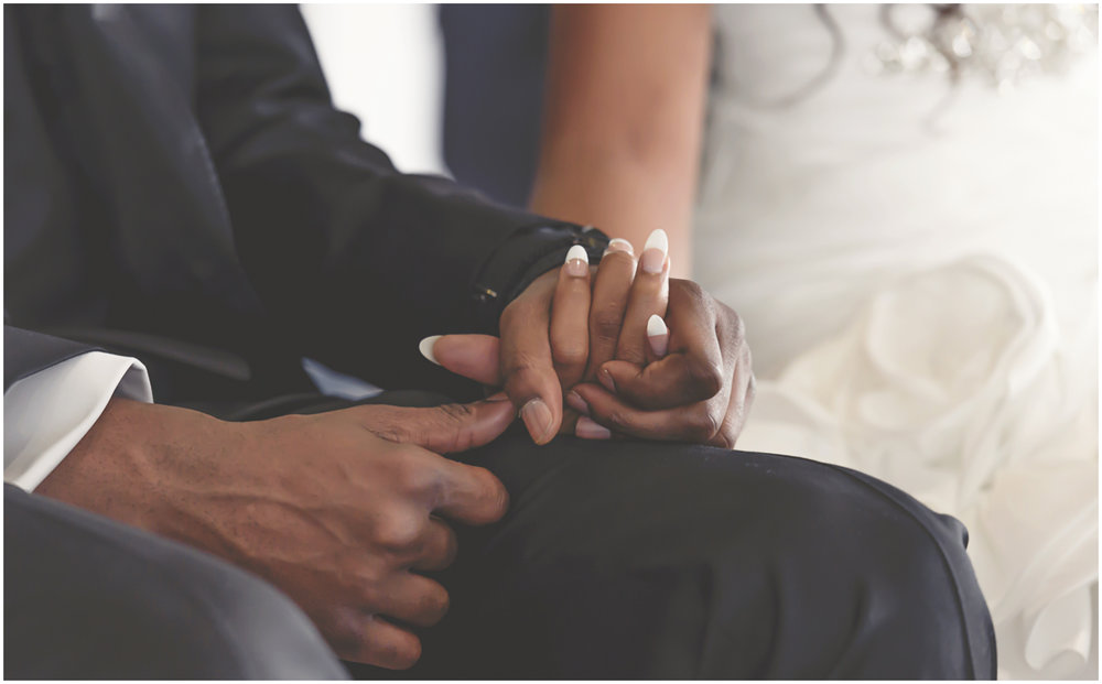 Bride and groom holding hands during their wedding