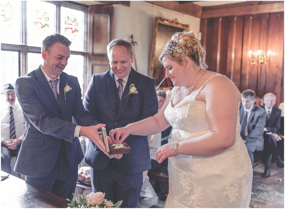 A bride and groom exchanging rings.