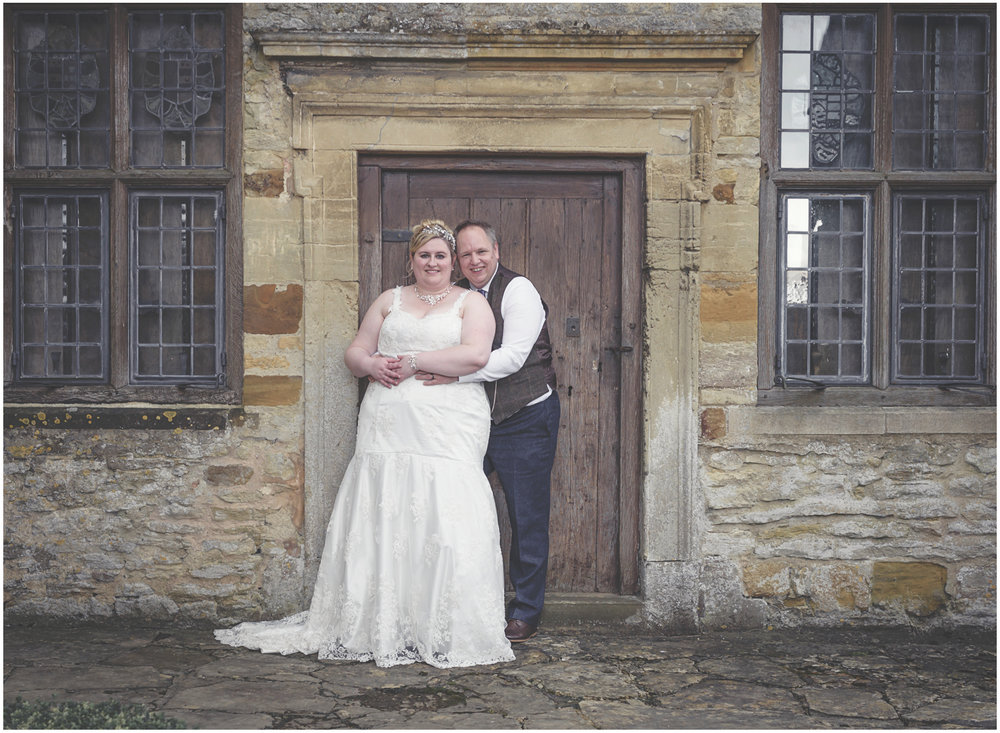 Bride and groom portrait outside the manor house