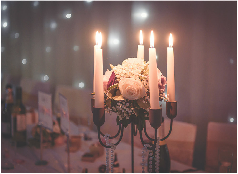 Candle lit table decoration for the wedding breakfast
