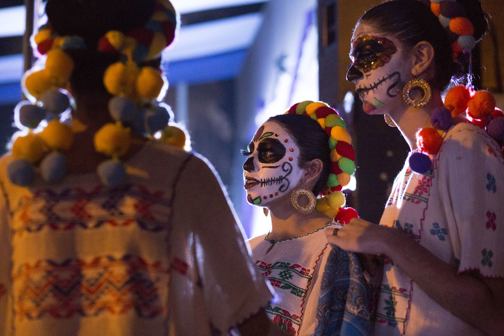 Three folkloric dancers dressed as Catrina Dolls watch other performers as they wait to take the stage during the Katrina Fest on Nov. 1, 2015 at Parque Abelardo L. Rodriguez in Rosarito. (Elaine Cromie)