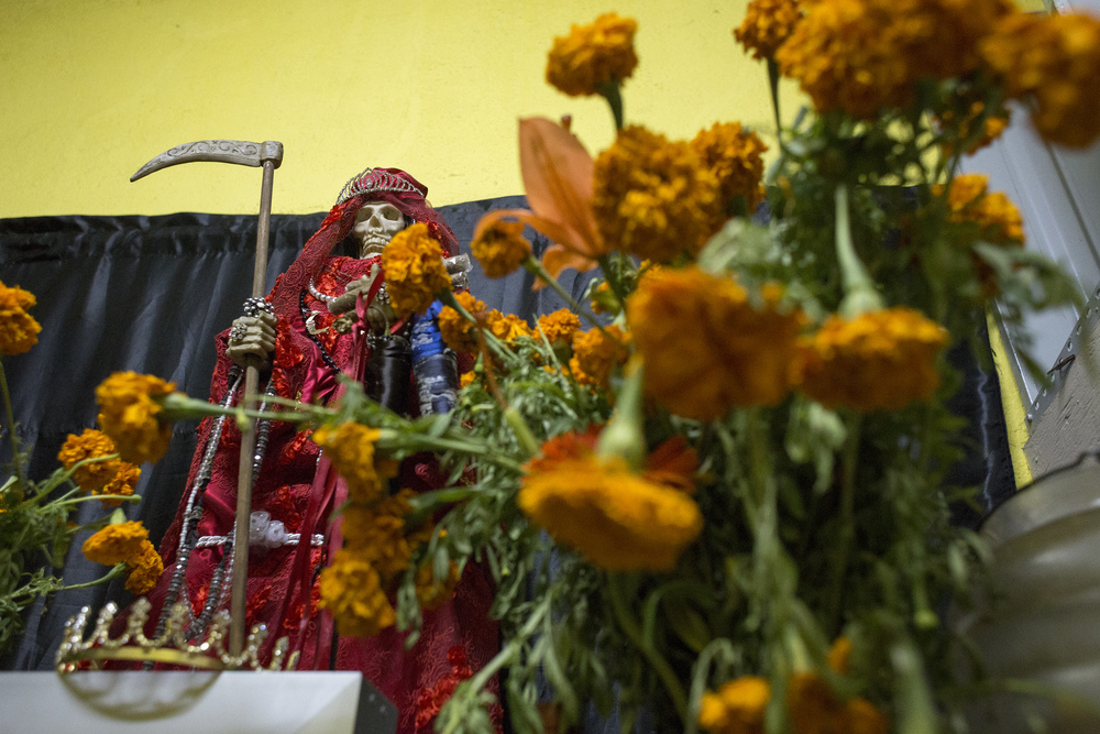 A small Santa Muerte altar stands in a back room of Botanica La Chula, a store next to another altar and a gathering spot for Santa Muerte followers in Tijuana. (Elaine Cromie)