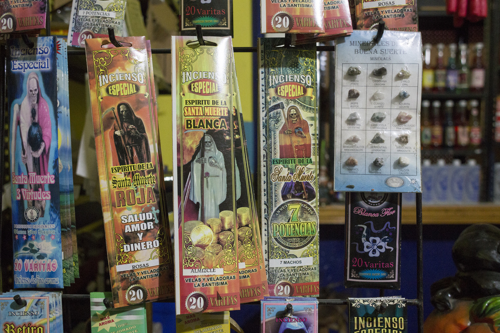 Incense and other goods are sold at Botanica la Chula, a store next to the altar, and a gathering spot for followers of Santa Muerte on Nov. 1, 2015 in Tijuana. (Elaine Cromie)