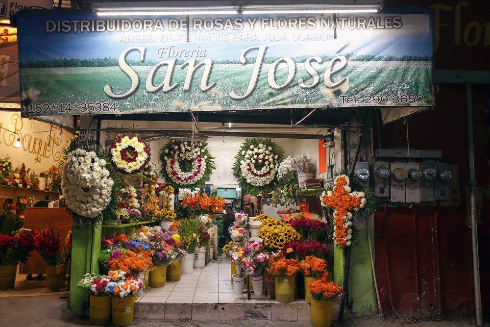 Halloween is a busy day for florists along the flower district of Tijuana. Children trick-or-treat late into the night, and others buy flowers in preparation for Día De Los Muertos, which takes place the following day. (Elaine Cromie)