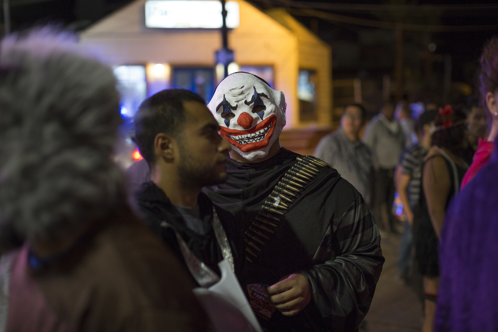 A man in costume waits in line at Papas and Beer, a popular night club on Oct. 31, 2015 in Rosarito. (Griselda San Martin)