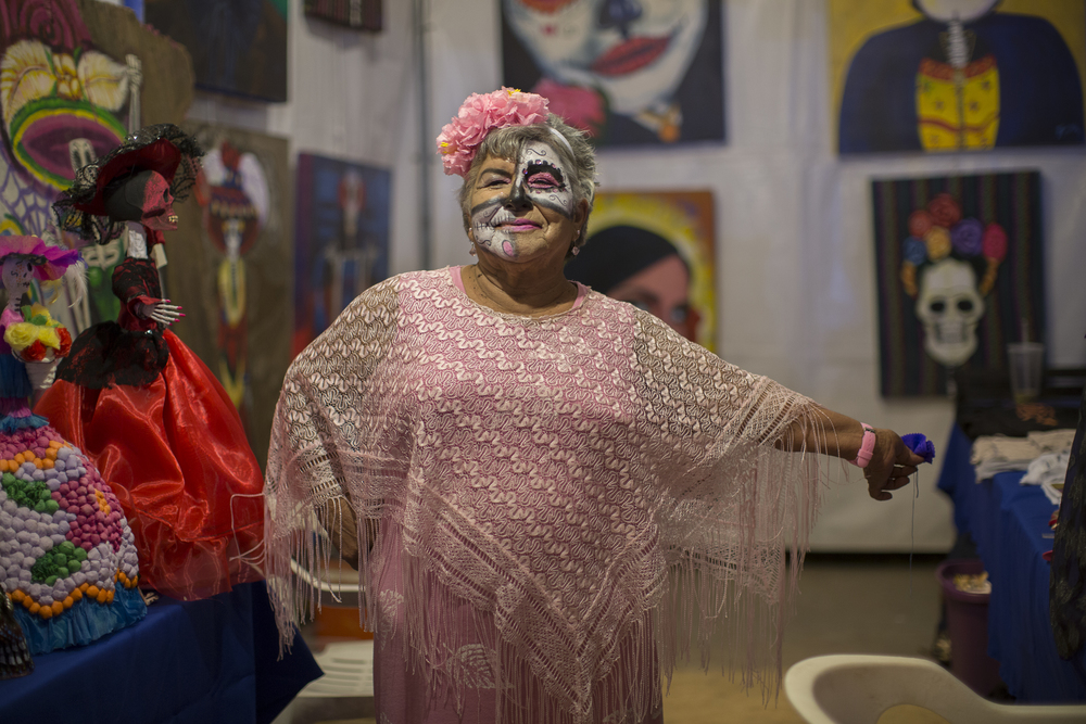 Josefina Cota stops selling Catrina Dolls to pose for a portrait at her stand at the Katrina Fest on Nov. 1, 2015 at Parque Abelardo L. Rodriguez in Rosarito to celebrate Día De Los Muertos. (Griselda San Martin)