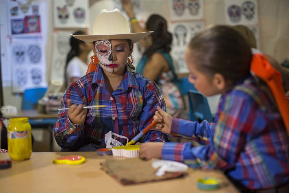 Two young girls paint a ceramic box in the shape of a skull at the Katrina Fest on Nov. 1, 2015 at Parque Abelardo L. Rodriguez in Rosarito in celebration of Día De Los Muertos. (Griselda San Martin)
