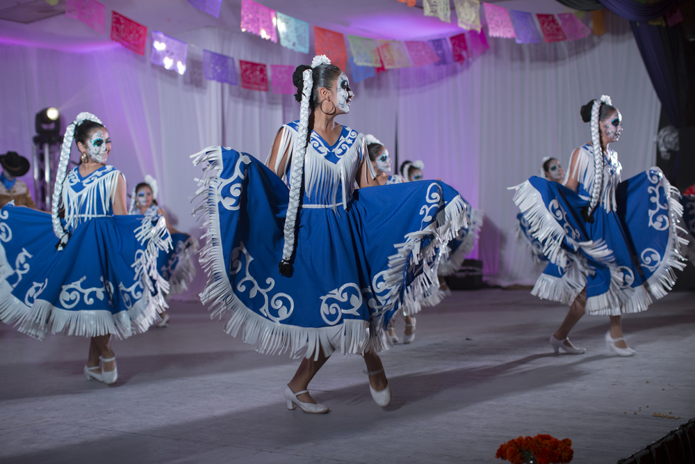 A row of folkloric dancers dressed as catrina dolls take the stage at the Katrina Fest at Parque Abelardo L. Rodriguez in Rosarito on Nov. 1, 2015 to celebrate Día De Los Muertos. The fest lasted two days, each day starting in the evening and running into the early morning. (Griselda San Martin)