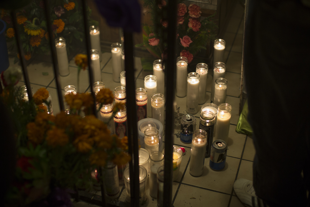 Candles, beer and other offerings are placed at the foot of the Santa Muerte altar on Nov. 1, 2015 at a neighborhood on the outskirts of Tijuana. (Griselda San Martin)