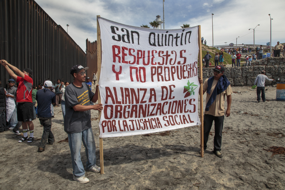 Protesters gather at the Mexico-U.S. border in Playas de Tijuana in March 2015. (Griselda San Martin)