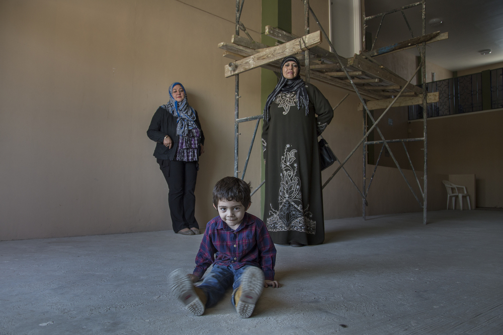 Hanna Vega and Maryam Alvarez stand with Alvarez's grandson, Abd Al Kabir at the mosque Al-Wajid in Rosarito, which is still under construction.   (Photo by Griselda San Martin)