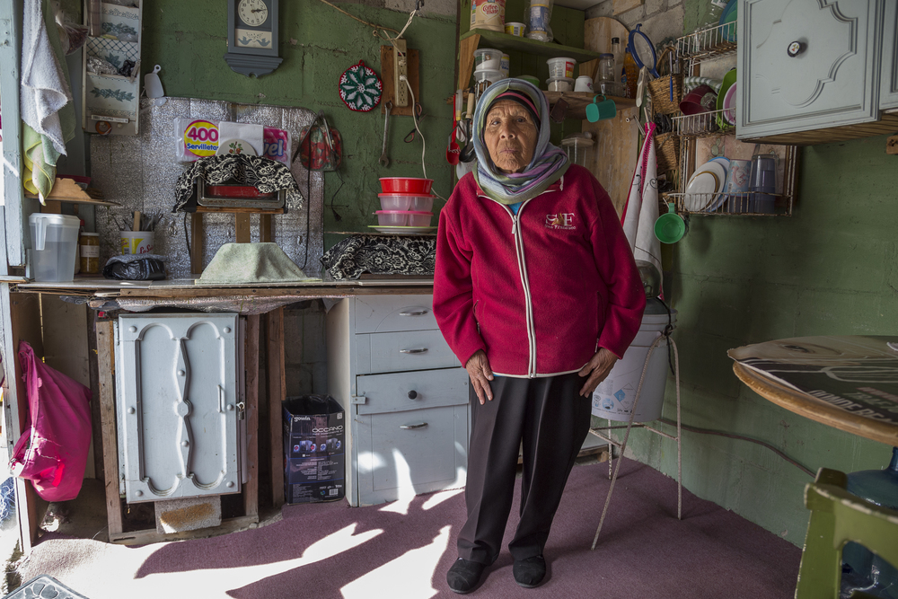 Juana Reza poses for a portrait at Irma Morales' house. Morales introduced her to Islam.   (Photo by Griselda San Martin)