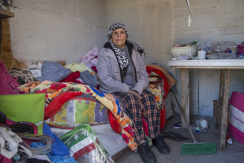 Maria de Lourdes Esquer, who turned 70 years old last month, sits in her bedroom that she rents for 600 pesos, about 35 dollars, a month.   (Photo by Griselda San Martin)