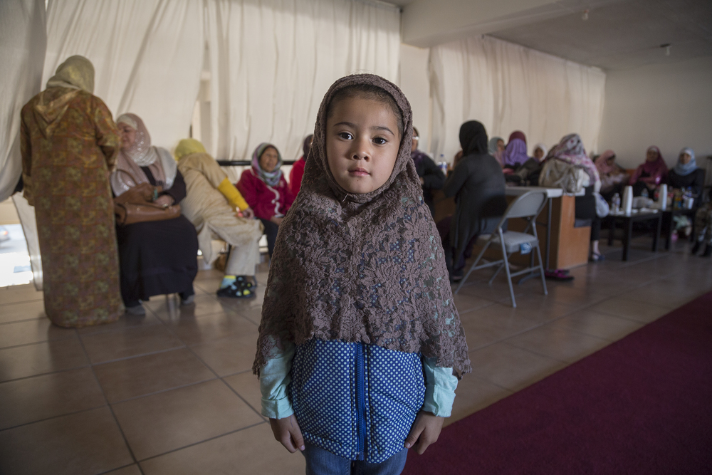 Ana Fer Garcia, 5, sits at a gathering in the mosque of Omar, in Playas de Tijuana. Ana Fer's mother is not a Muslim. She attended the event with her daughters to find out more about the religion.   (Photo by Griselda San Martin)