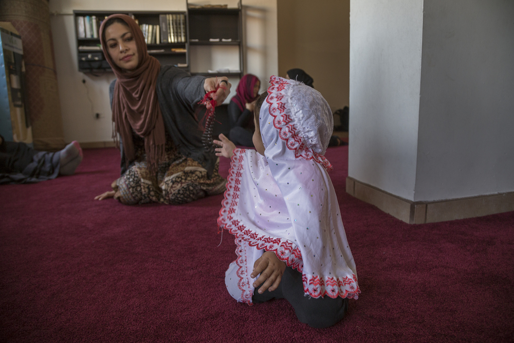 Iman Abi sits with her daughter Mahnoor at a gathering in the mosque of Omar, in Playas de Tijuana.   (Photo by Griselda San Martin)