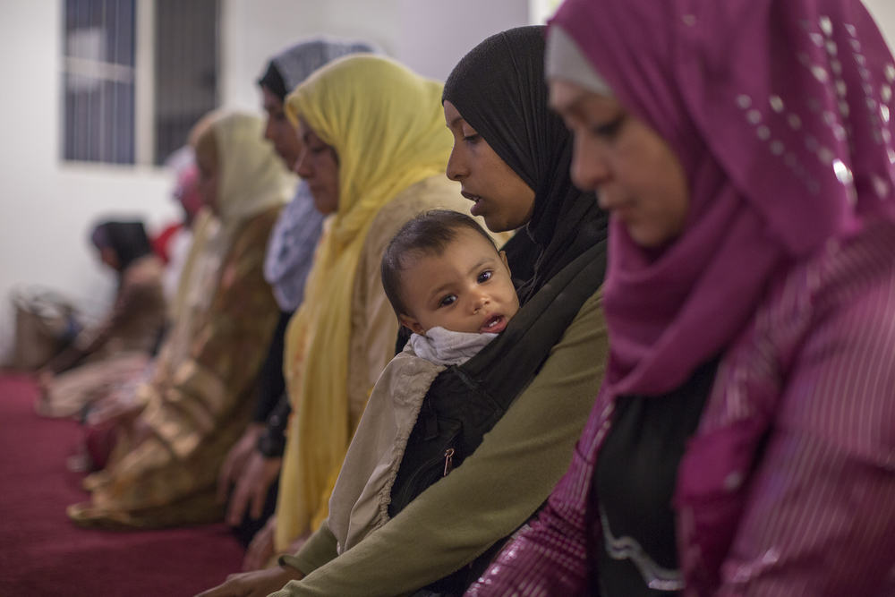 Shayla Garcia and her baby daughter Suhayla sit during prayer time at the mosque of Omar in Playas de Tijuana.   (Photo by Griselda San Martin)