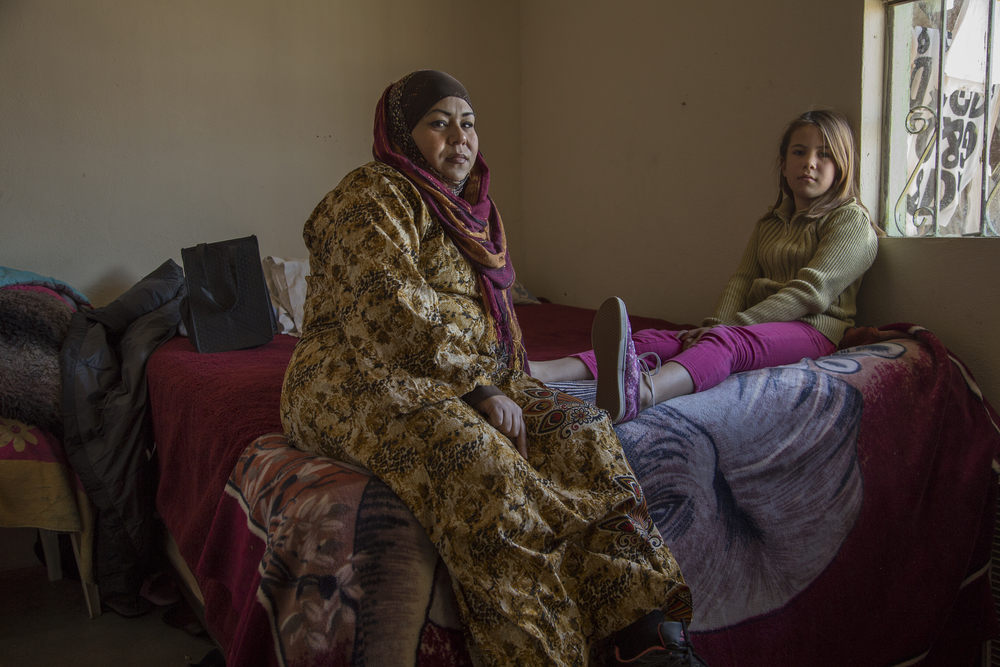 Fatima Castañeda sits with her daughter Naomi, 10, in their apartment in Rosarito. (Photo by Griselda San Martin)