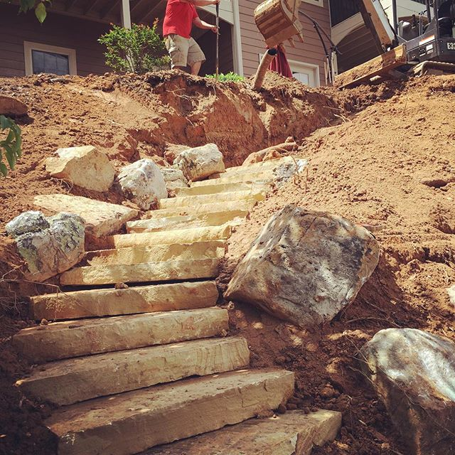 Setting Tennessee Flagstone snapped-edge steps today on our Lake Keowee renovation, prepping the backyard for the Memorial Day weekend!