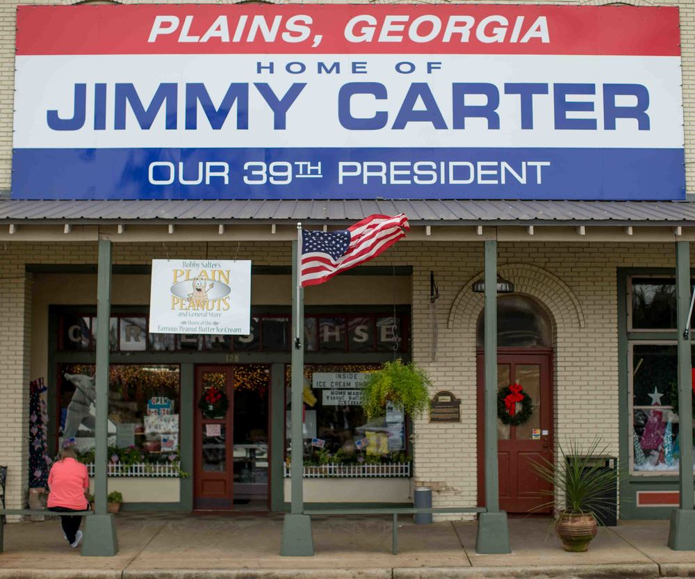 "A view of downtown Plains, Ga., Sunday, Dec. 13, 2015.  A recent MRI showing no cancer on Jimmy Carter's brain is ""very positive"" news for the former president but will not end his medical treatment, doctors said. Carter, 91, announced Dec. 6 that doctors found no evidence of the four lesions discovered on his brain this summer and no signs of new cancer growth. (AP Photo/Branden Camp)"
