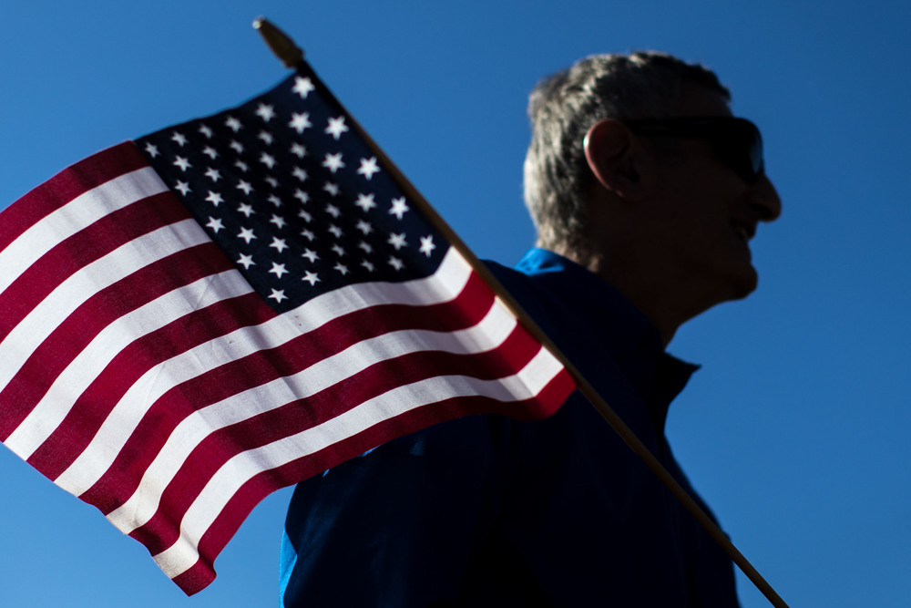 Nov. 11, 2015 - Marietta, Ga, U.S - GEORGE ESSAFF holds a flag during a Veterans Day parade. (Credit Image: © Branden Camp via ZUMA Wire)