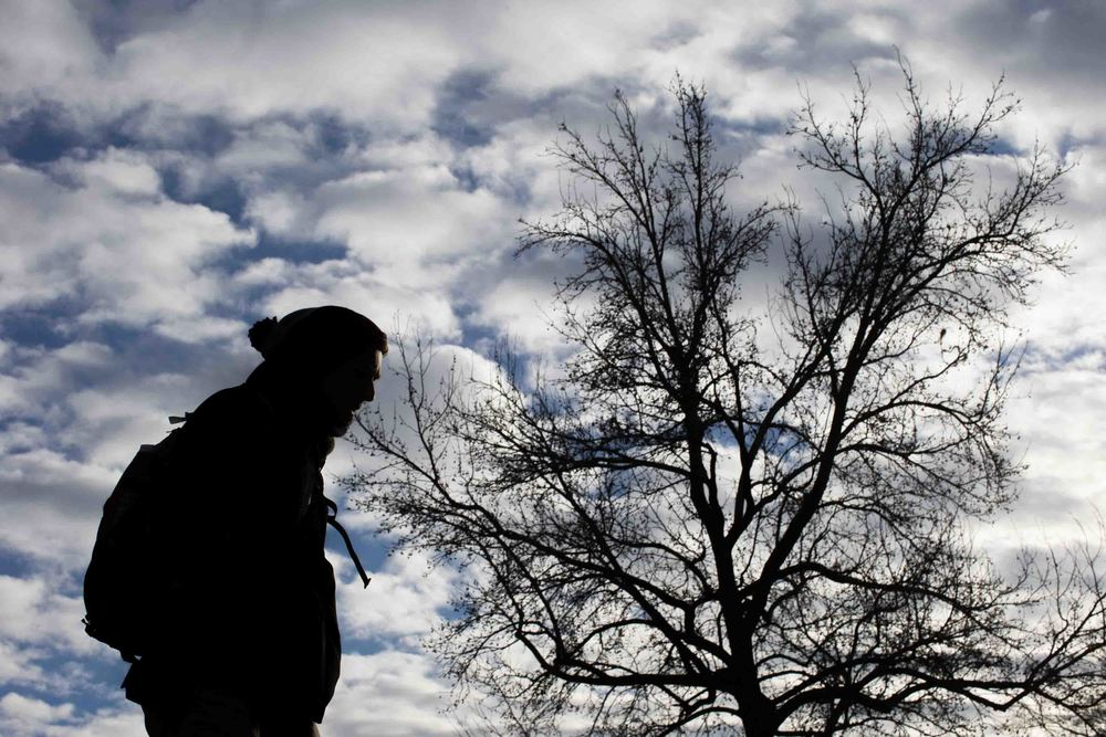 A Kennesaw State University student walks on campus on a cold day, Wednesday, Feb. 10, 2016, in Kennesaw, Ga. (AP Photo/Branden Camp)