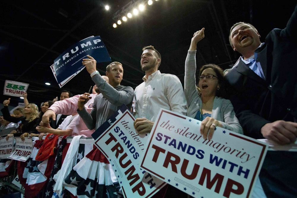 People cheer as Republican presidential candidate Donald Trump speaks during a campaign rally at the Georgia World Congress Center, February 21, 2016 in Atlanta, Georgia. Trump won the South Carolina Republican primary over nearest rivals Sen. Marco Rubio (R-FL) and Sen. Ted Cruz (R-TX).  Branden Camp/Getty Images