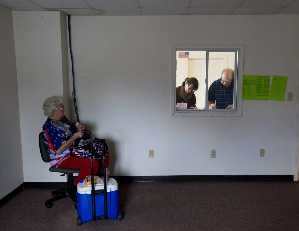 WHITE, GA - MARCH 1, 2016:  81-year-old Helen Free, left, a polling site assistant manager, takes a lunch break while two Georgia voters fill out voting paper work before casting their ballots on Super Tuesday March 1, 2016, in White, Georgia. Voters head to the polls to cast their votes on Georgia's presidential primary. (Photo by Branden Camp/Getty Images)